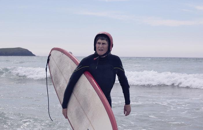 Gwyn Haslock Surfing Land Rover