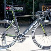 An aero road bike in black and florescent yellow