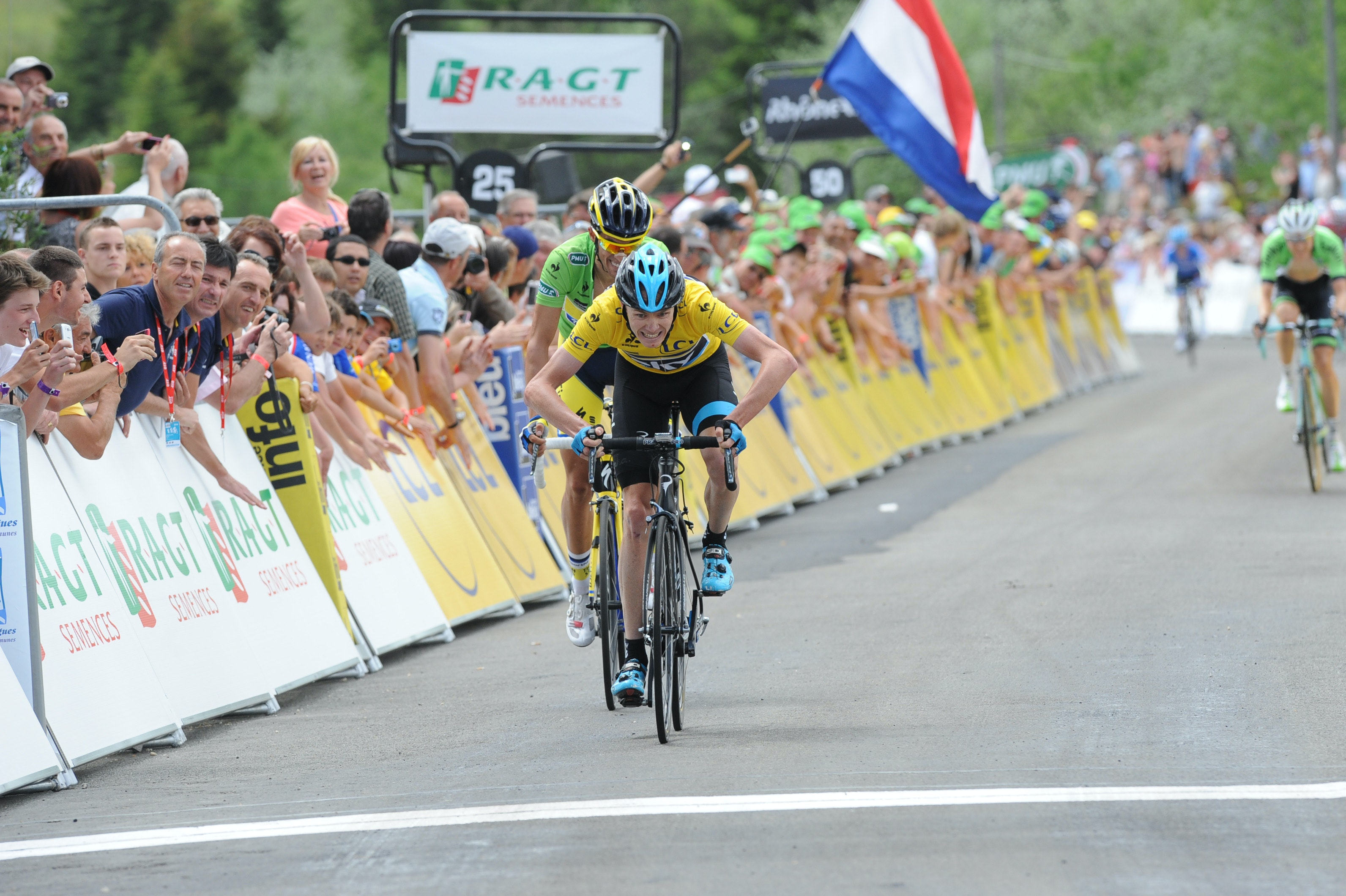 Chris Froome, Team Sky, yellow jersey, sprint, throw, Criterium du Dauphine, 2014, stage two, Col du Beal, pic: Sirotti