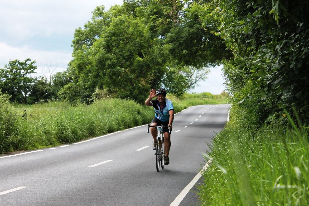 Cyclist, waving, sportive, pic: Colin Henrys/Factory Media