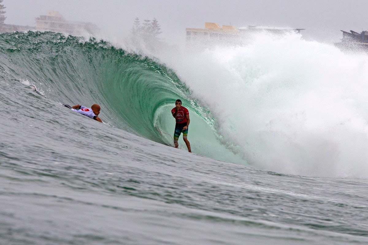 Joel Parkinson raises his middle finger at Kelly Slater during the final of the 2013 Quik Pro