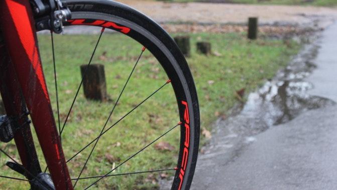 wet wheel road rain cycling