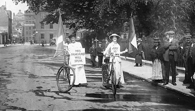 Two suffragettes on bicycles in 1914. Photograph- Corbis